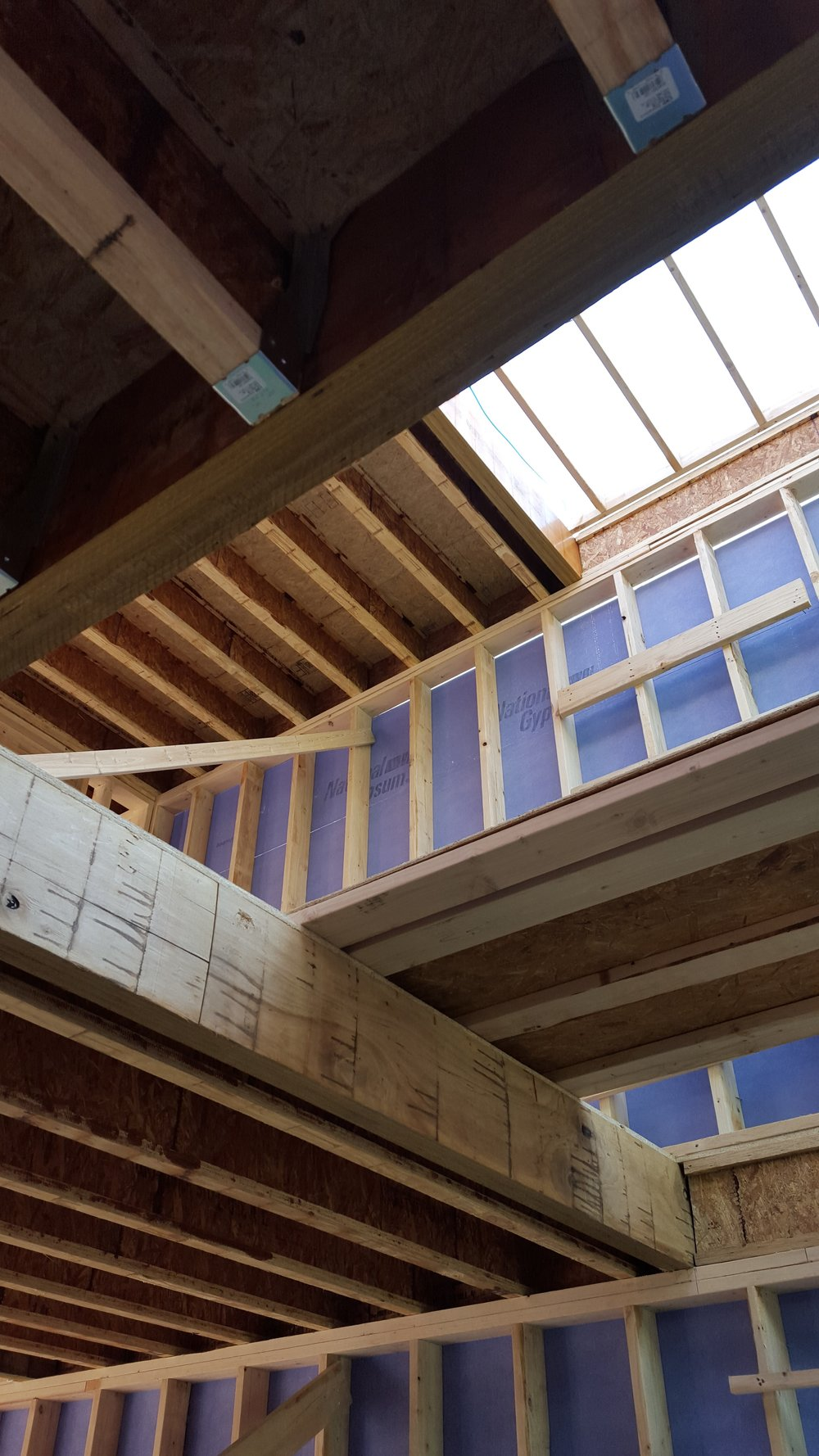interior view of framing; because of the width of the house, we needed to use wood I-joists for the floors and roof
