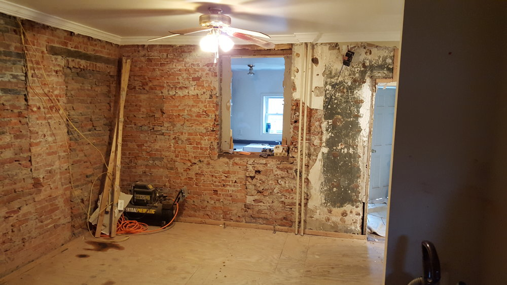 These brick walls tell a story of many changes over time. Much of the brick will remain exposed.