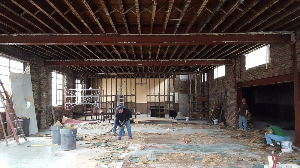 The main space on the first floor during demolition.
