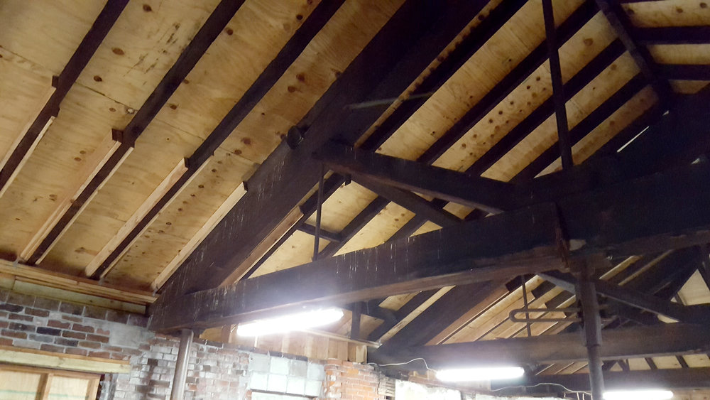 Carriages used to be stored in here; the large roof trusses also hold up the second floor, so that the first floor could be totally open. There's evidence that at one time there was an elevator (manually operated, of course) that could lift carriages up to the second level.