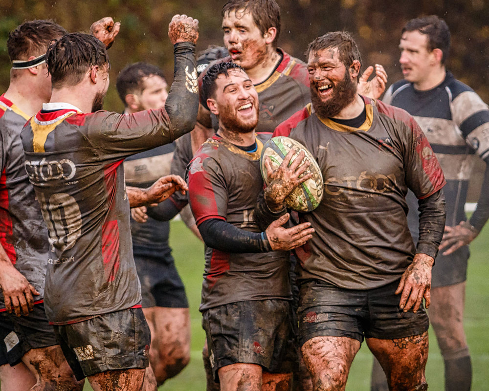 A mudded but happy Ryan Wederell celebrates his try