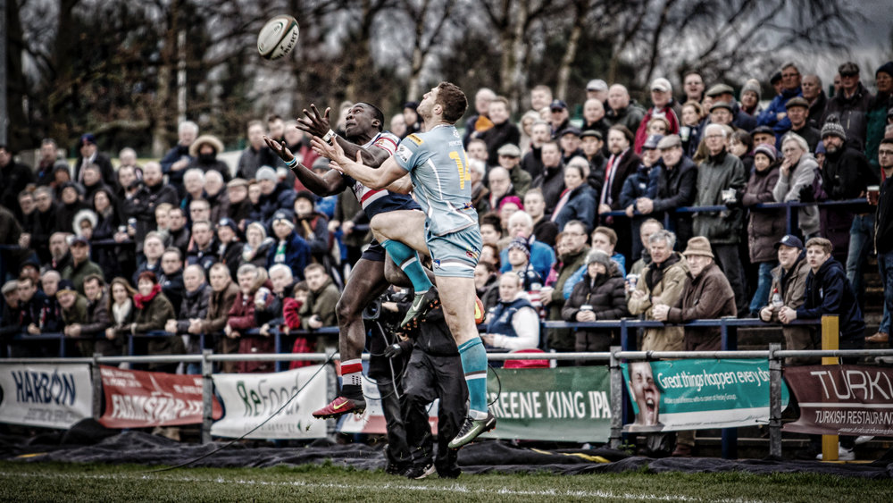 Knights' Tyson Lewis leaps for the ball in front of an expectant crowd