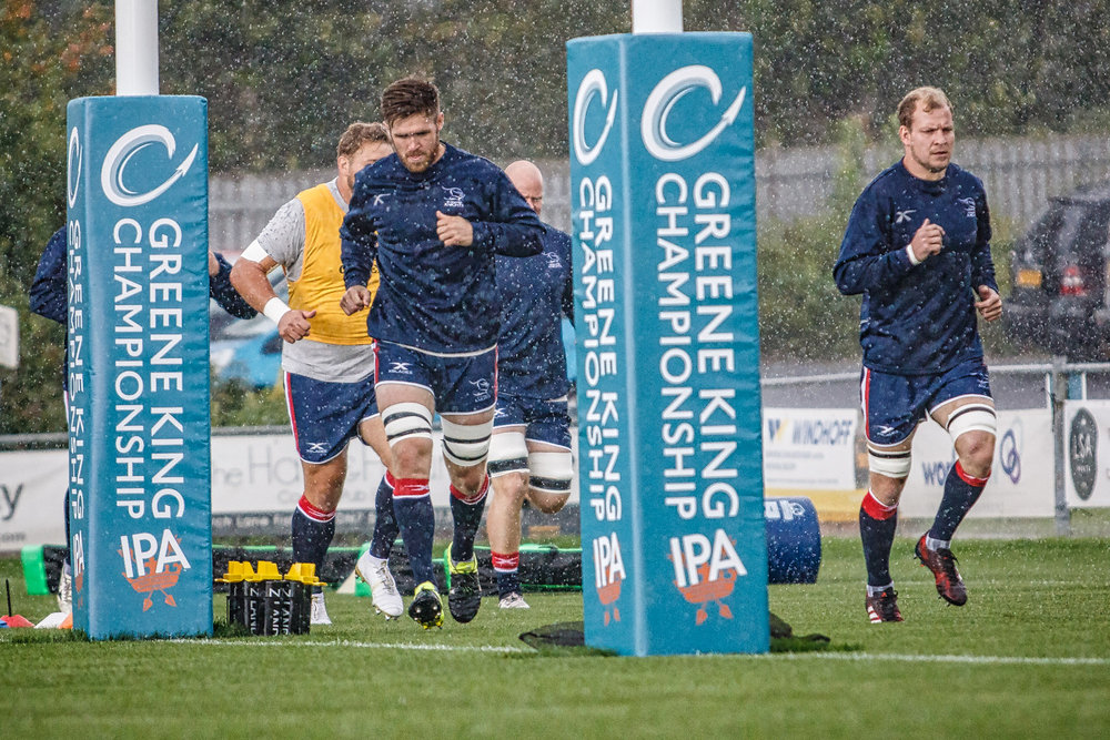 Pre-match downpour failed to dampen the spirits. Lee Shaw (left) was to score Knights' first try
