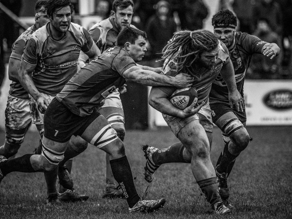 Possibly my favourite of the day - Dale's Adam Howard drives forward. I think the graininess looks better in black and white