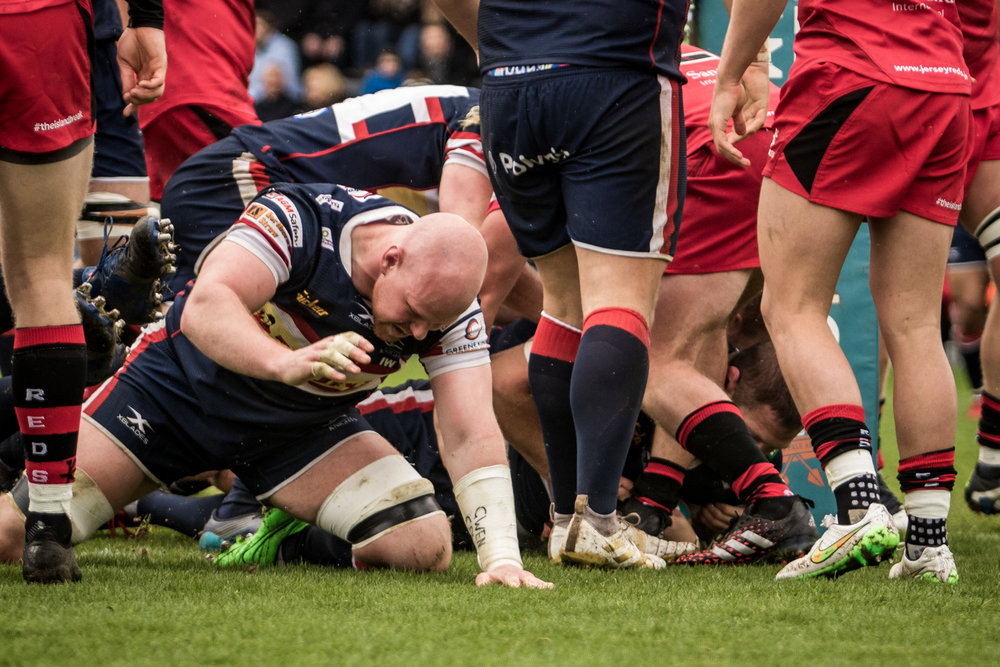 Try for Matt Challinor - through a sea of legs