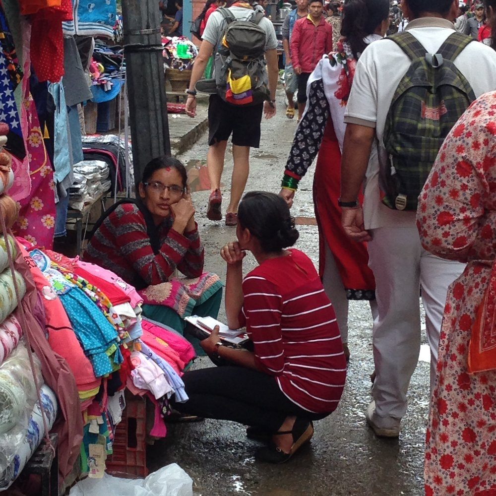 Youth talking with a clothes vendor