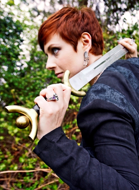 Shot from the Valkyrie Collection.  We used one of my husbands many swords.  Inspired by myths and legends of the Vikings.