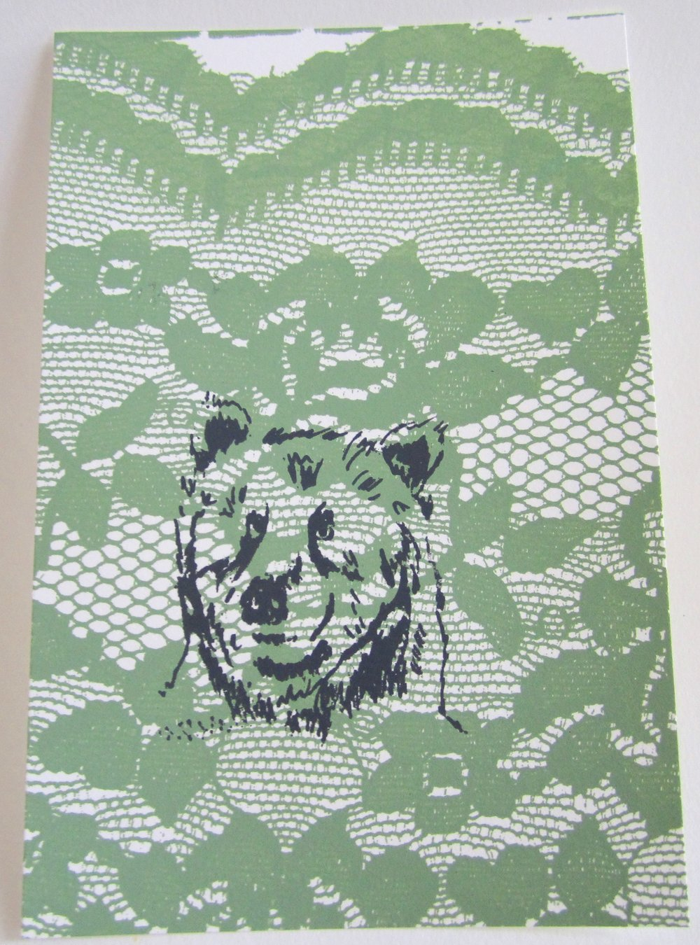 A print of a bear on lace, I did this for my screenprinting class at ECU in 2011.