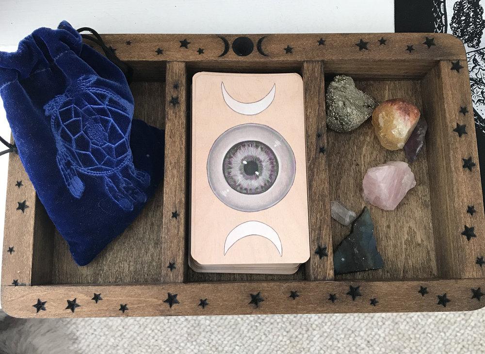 My tarot keepsake box made by Stone and Violet. My runes, Skullgarden tarot deck and gemstones.