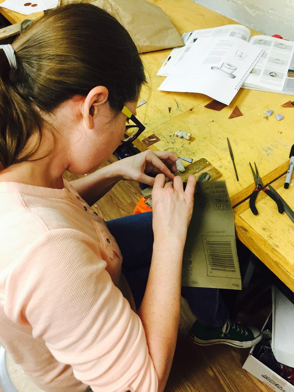 My friend Carrie sanding her piece.