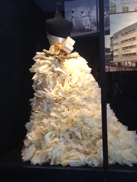 Chris made the skirt of this dress out of hundreds of tissues.  He loves the creativity of this work and the opportunity to tell a story in a window.