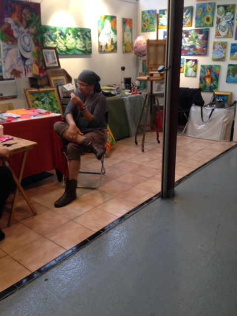 a vendor selling paintings in La Marqueta