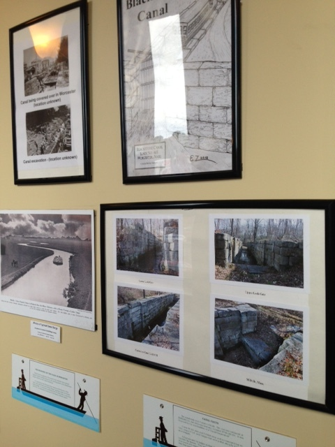 A curated exhibit along the length of the corridor walls leading to Birch Tree Bread Company explores the history of the Blackstone Canal and its link to Worcester's successful industrial past.