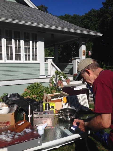Paul selling some pots and pans at the community yard sale.  We talked for such a long time that he even invited me in for a tour of his craftsman house.  I sat on his porch for a bit and watched people walk down the pedestrian lane.