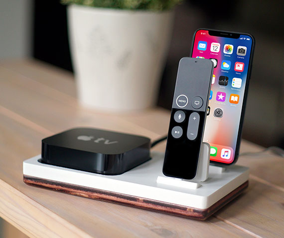TVstnd 4K 2   Charges an iPhone 8, X, XS, XS Max & XR, Apple TV Remote (4th Gen & 4K Gen) with a base holder for the Apple TV unit! White and Midnight versions are within the listing.