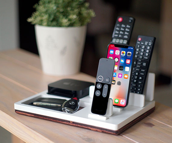 TVstnd 4K 3   Charges an iPhone 8, X, XS, XS Max & XR, Apple TV Remote (4th Gen & 4K Gen), regular remotes slots with a base holder for the Apple TV unit! White and Midnight versions are within the listing.