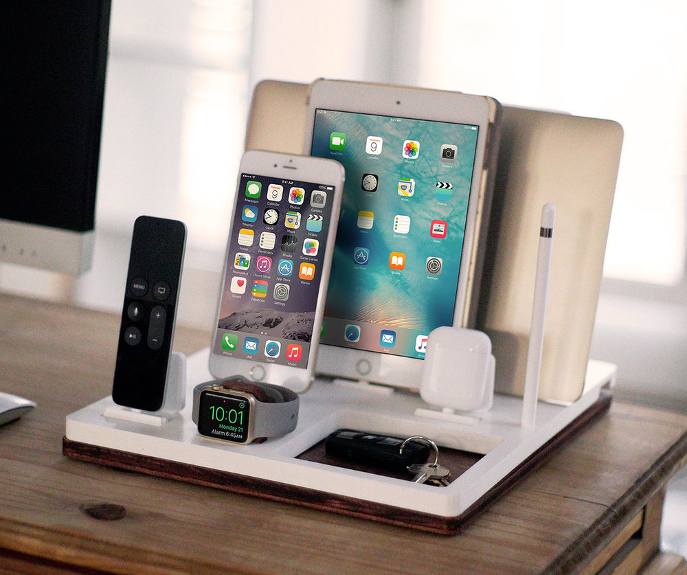 DskStnd FIVE   Charges an iPhone 5 & Up including 8, X, XS, XS Max & XR, Apple Watch, AirPods, iPad, Apple TV Remote, Apple Pencil holder, Mac/PC Holder with a tray area for a wallet, keys, etc! White and Midnight versions are within the listing.