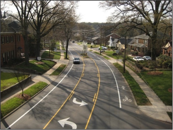 Example of a road that has undergone a road diet and become a more complete street.  Source:   Charmeck.org