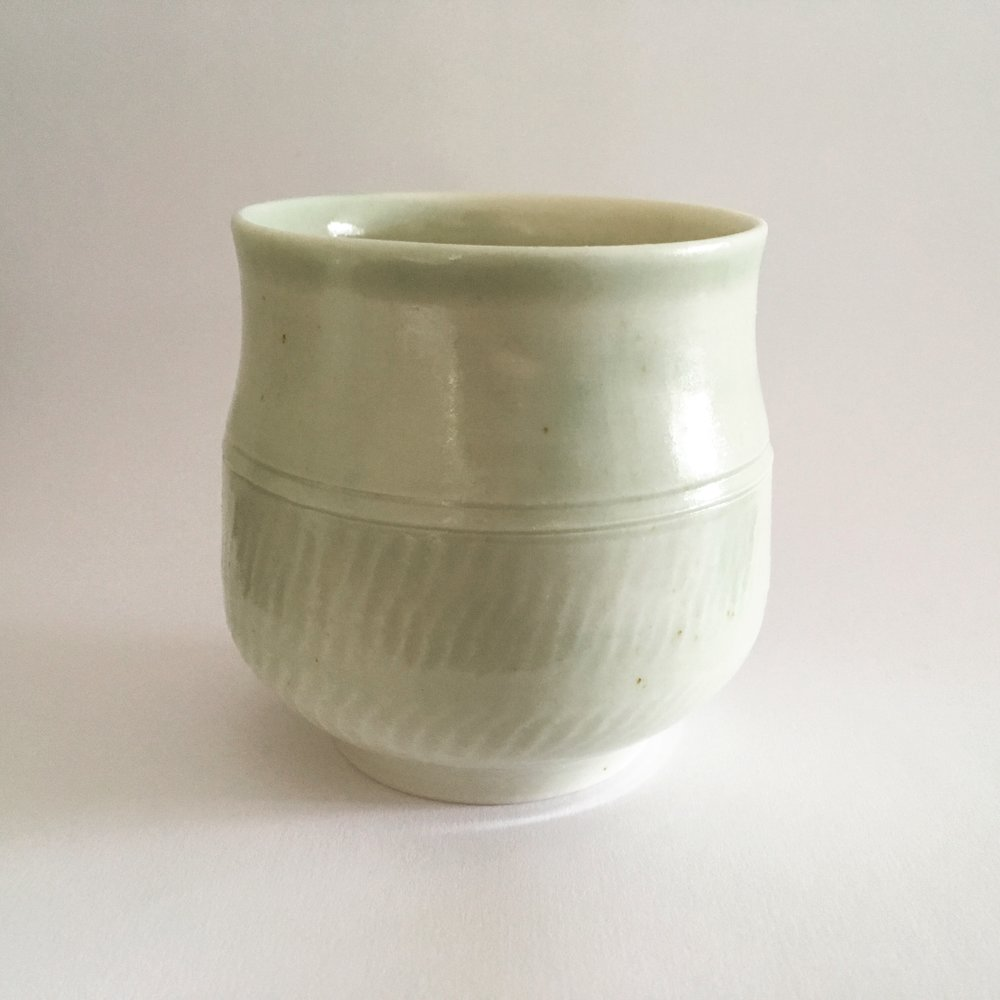 Porcelain yunomi   Porcelain cup with hammering technique and celadon ash glaze from local trees (Staatsbosbeheer, NL)   Ø 7cm - €30