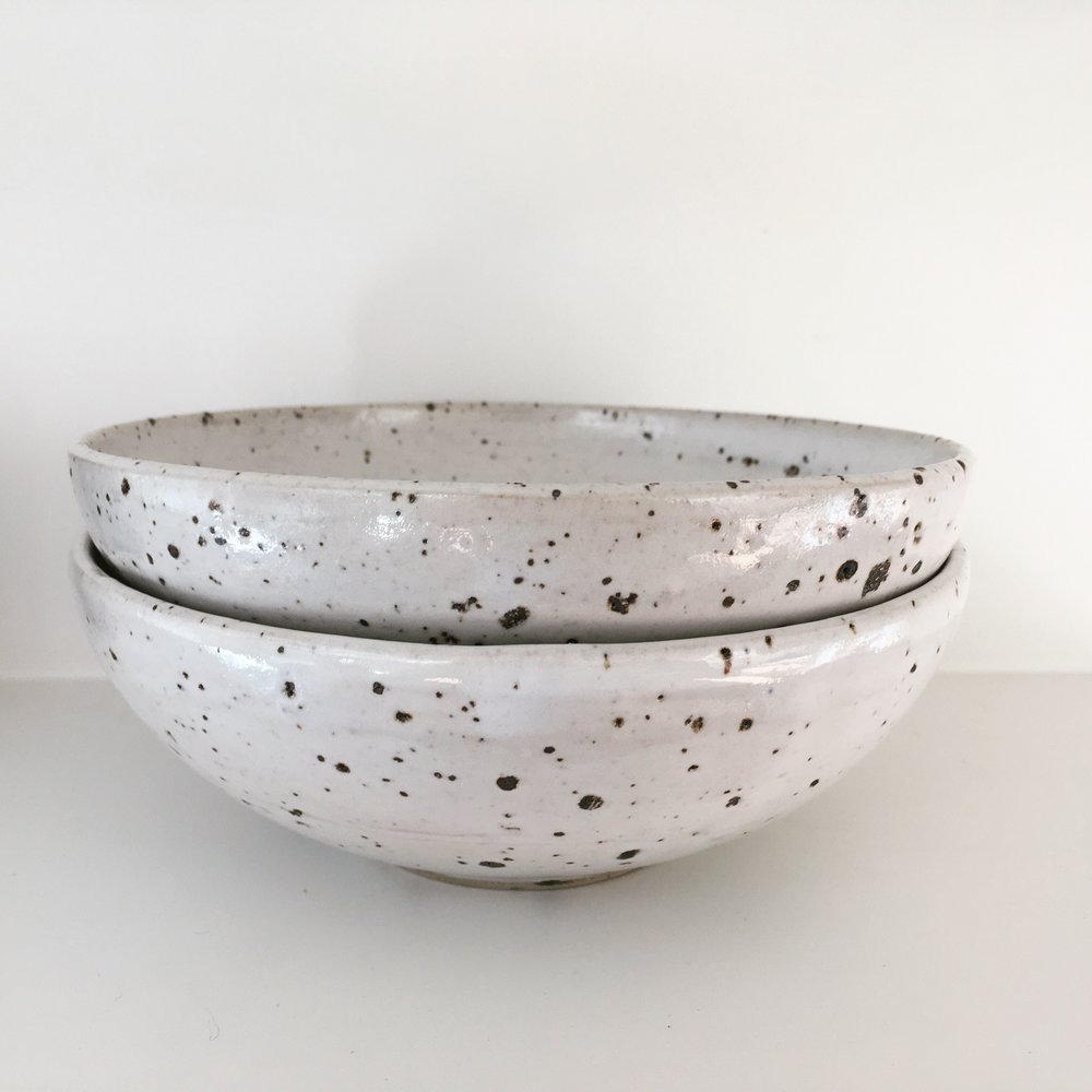 Breakfast bowls   Bowl with mixed in local clay containing iron, covered in white zirconium glaze.   Ø 15cm - €25