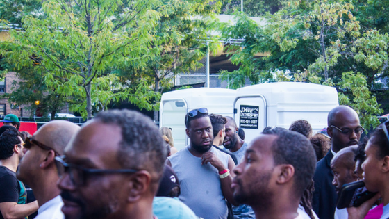 Robert Glasper was chillin in the background, chatting with friends.