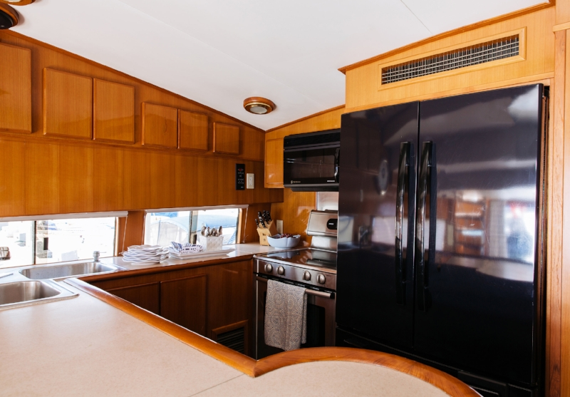 Full size galley with double refrigerator, stove, oven, microwave, and Nespresso machine