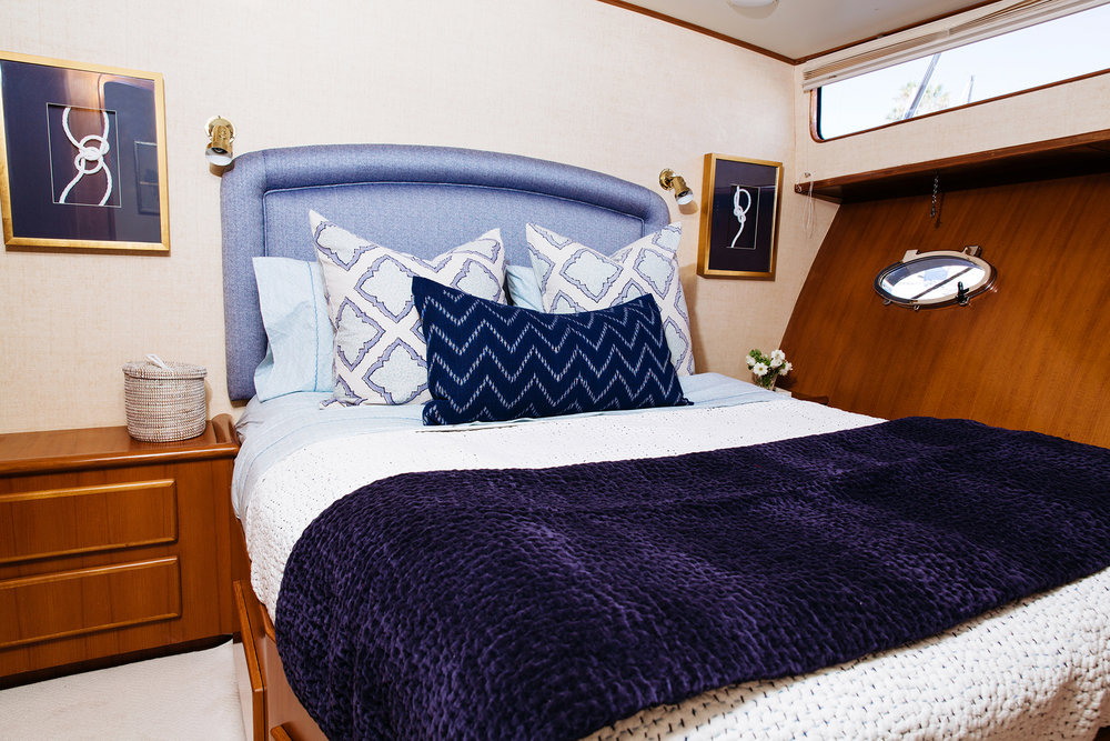 Mid stateroom with queen bed and full bath