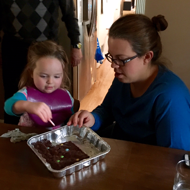 Ellie could not wait to sing happy birthday to her mom, and to eat the birthday brownie cake