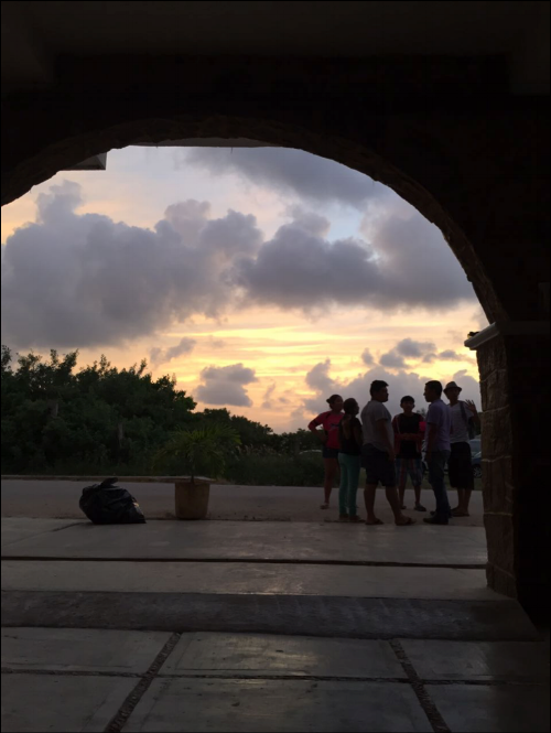 When waiting for the ferry or a transport from the Island back to Cancun, you often find groups like this against the back drop of a stunning sunset. Road side conversations are a way of living here.