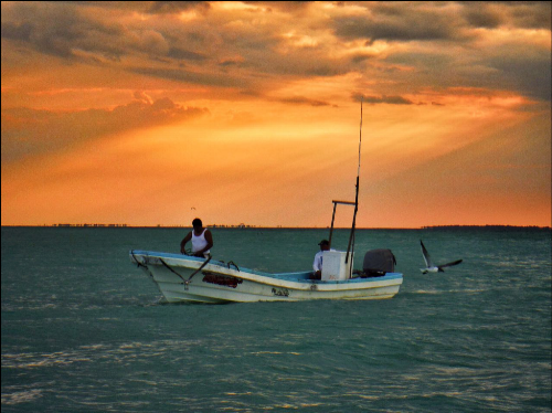 """On the Lancha at Sunset"" Fishing is a way of life here. Though tourism has started to encroach upon the culture of this place, it has yet to inhibit the founding industry."