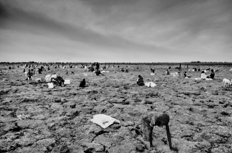 Today's image: Community members search for spilled grain on the site of a World Food Program airdrop in Ganyiel, South Sudan, on March 10, 2016. Ganyiel is a small community that has become a safe haven and a center for relief distribution for over 90,000 people in the conflict-torn nation of South Sudan. ( source )