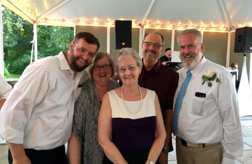 More from the wedding. We're just missing Brian's brother Jim in this sweet family photo.