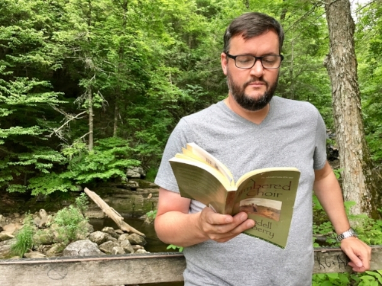 "Brian reading from Berry's ""a Timbered Choir"" during a summer hike up Kent Falls in Kent, CT"