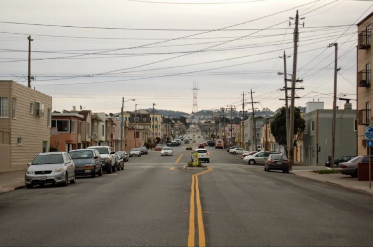 "( 2015 )  ""The neighborhood we live in now--The Outer Sunset--is the one I hope to stay in long-term. While the rest of the city is louder and wilder and full of local shops and interesting goings-on, the Sunset is quiet. You don't move here to get the ""San Francisco experience,"" you move here because you need to. Our neighborhood is spread out, housing is more affordable, and space is easier to come by. We are a community of upper middle-class families, surfers, and first or second generation immigrants (many whose families have owned these houses for 30 years). This is the one city in the US where housing is cheaper by the ocean. Because of that blanket of fog that arrives and sits over the view for half the year, the Outer Sunset is the least sunny place in SF. Our homes may have views of the ocean, but that doesn't mean we can see it."