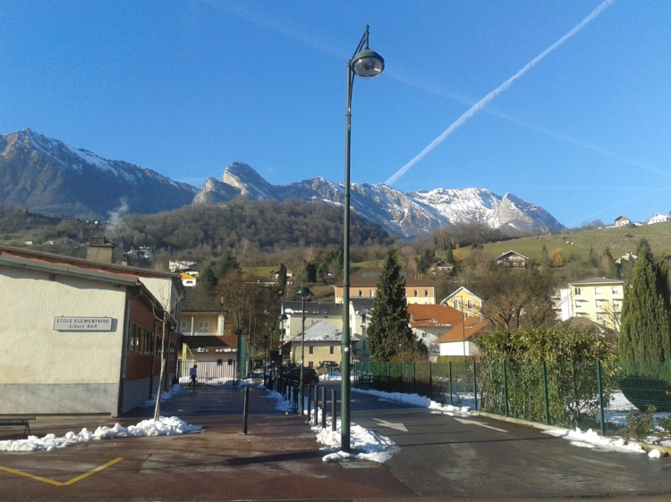 """[In Albertville] We were welcomed by the snow-covered Alps and have been watching the sun rise and set over them since. This is the view from my window as I write.  Physical activity, especially skiing is built into the culture, into the school system, in fact. There are bike lanes next to the roads complete with their own special signs, walking and bike paths and trails, and of course like much of Europe, comprehensive bus systems and trains strategically placed in order to get easily, and environmentally-consciously from here to there."""