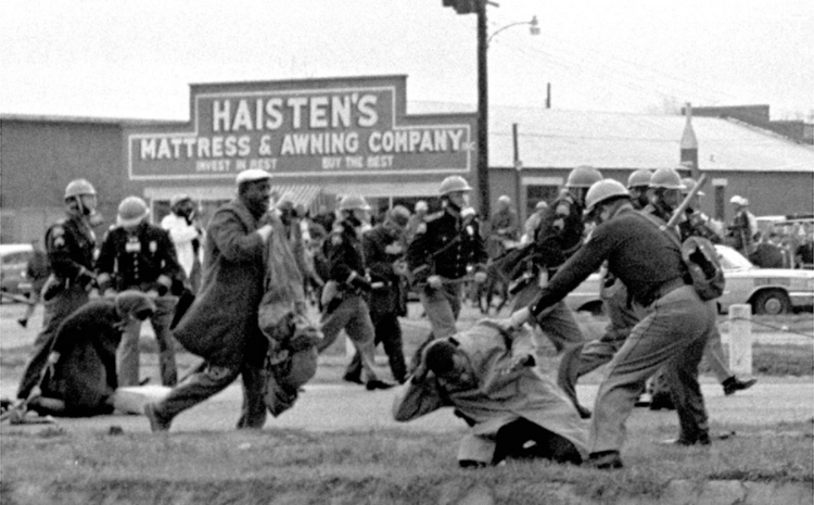 State troopers swing billy clubs to break up a civil rights voting march in Selma, Alabama, on March 7, 1965. John Lewis, the chairman of the Student Nonviolent Coordinating Committee (in the foreground) is being beaten by state troopers. Lewis would go on to become a U.S. congressman, elected as the representative for Georgia's 5th congressional district in 1986.(AP)  ( source )