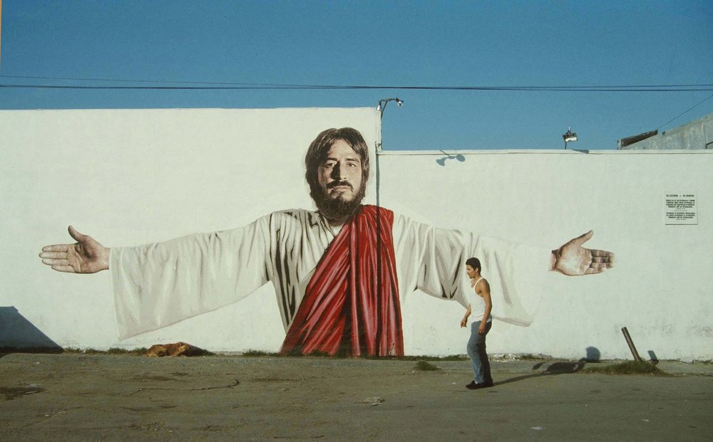 111TH STREET JESUS  by Kent Twitchell ( source )  Tiger Liquor Store, corner of Vermont Avenue at 111th Streets, Los Angeles 1984. Painted out circa 1999. (H/T:  Image Journal )
