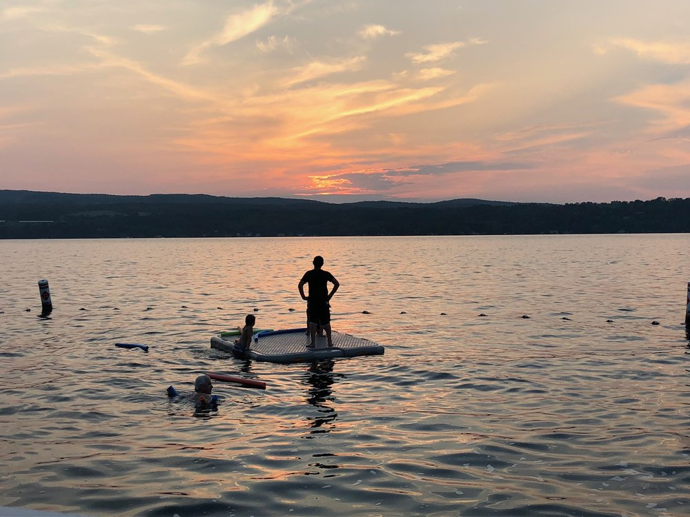 Nephews sunset swimming during our annual  Hill family vacation  on Canandaigua Lake, NY.