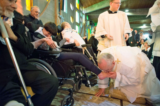 Pope Francis kisses the foot of a woman at the Don Gnocchi Foundation Center in Rome on April 17, 2014. AP   Source