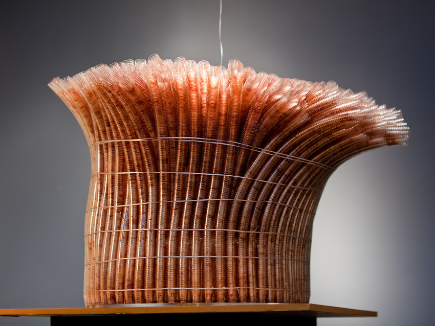 Tabernacle,  Denise Kufus Weyhrich  70,000 communion cups collected after use from Easter 2009 to Yom Kippur 2010 held together with 7 silver ribbons reaching to the heavens. 3'x3' 2011   Source