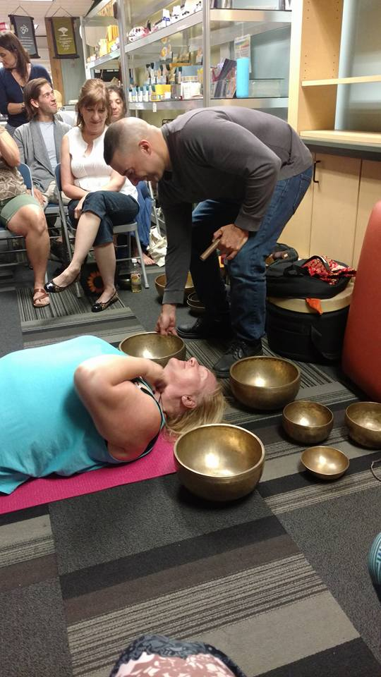 A very WILLING volunteer for a short demonstration on how a session of singing bowl therapy would happen.