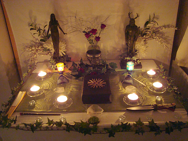 An altar for spell craft, prayers, and dedication. Elegant and chic. Set up methodically with all elements present.