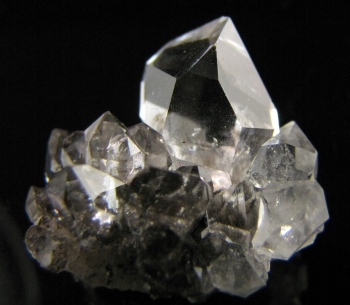 A rare cluster. Herkimer diamonds come out of the ground looking polished. They are clear, sometimes with a little sediment, and usually an air pocket.