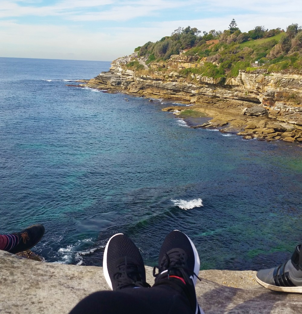 Sitting on a cliff at a Beach in Australia