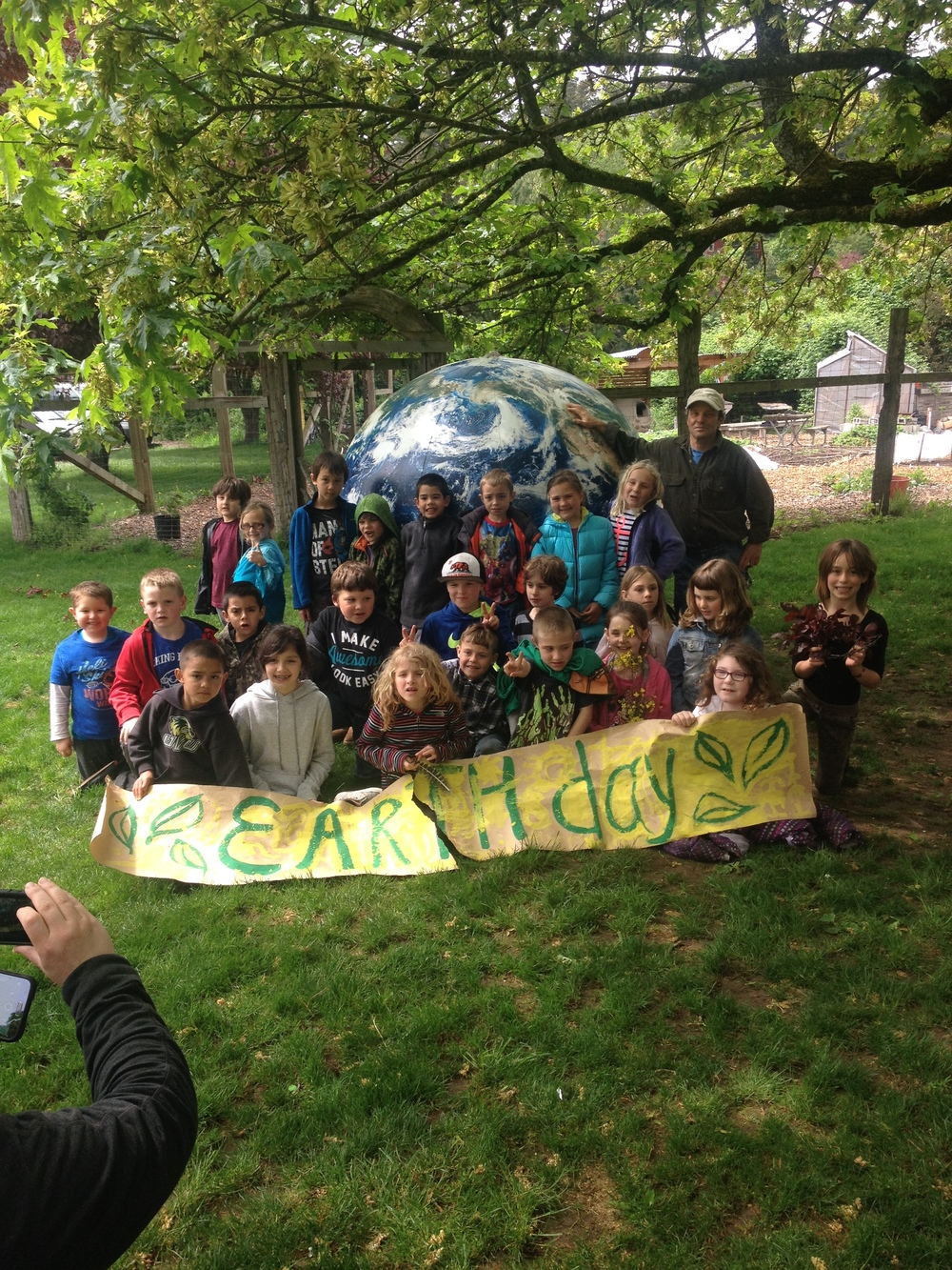 Our 2nd grade class carried the Earth with care and excitement during the parade!