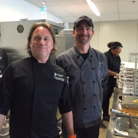 Chef Raymond Southern with Chef Zack serving a delicious Mediterranean meal.