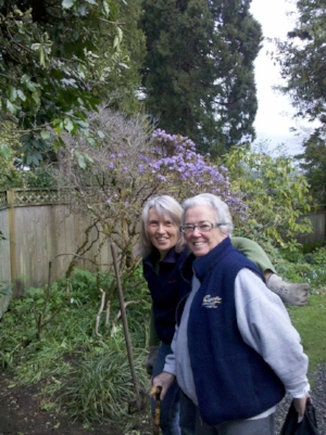 Marilyn with Sheryl Quine in her garden. Marilyn spent hours searching through plant catalogs, ordering plants for her yard.