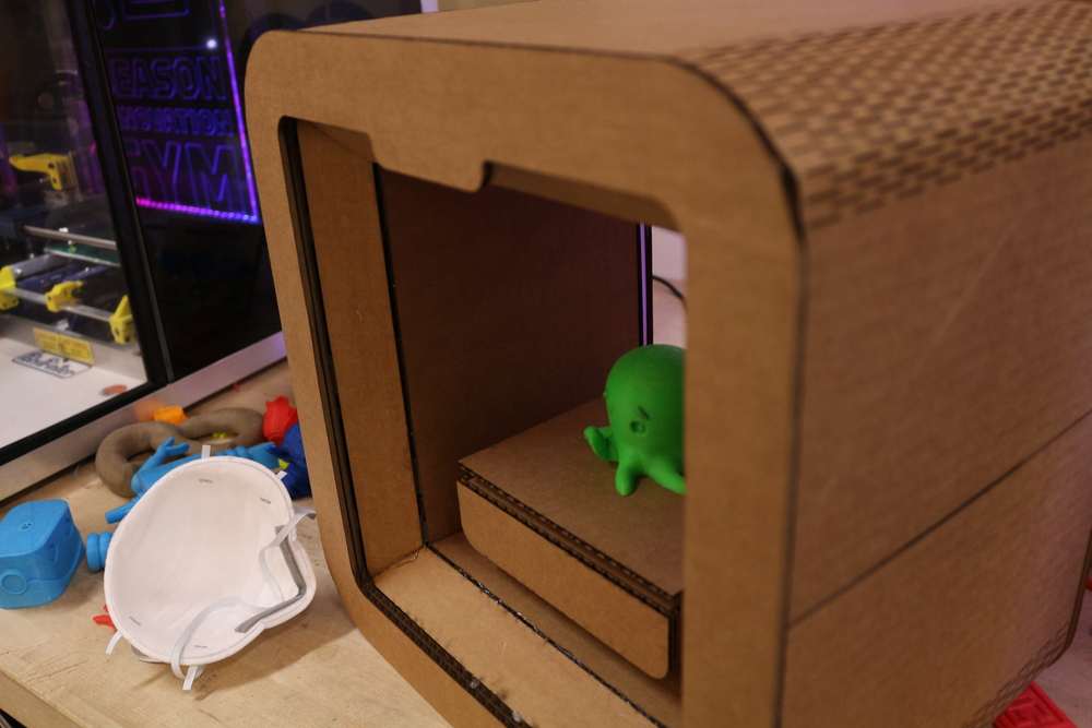 Cardboard scale prototype of a 3D printer that could go on the cart.