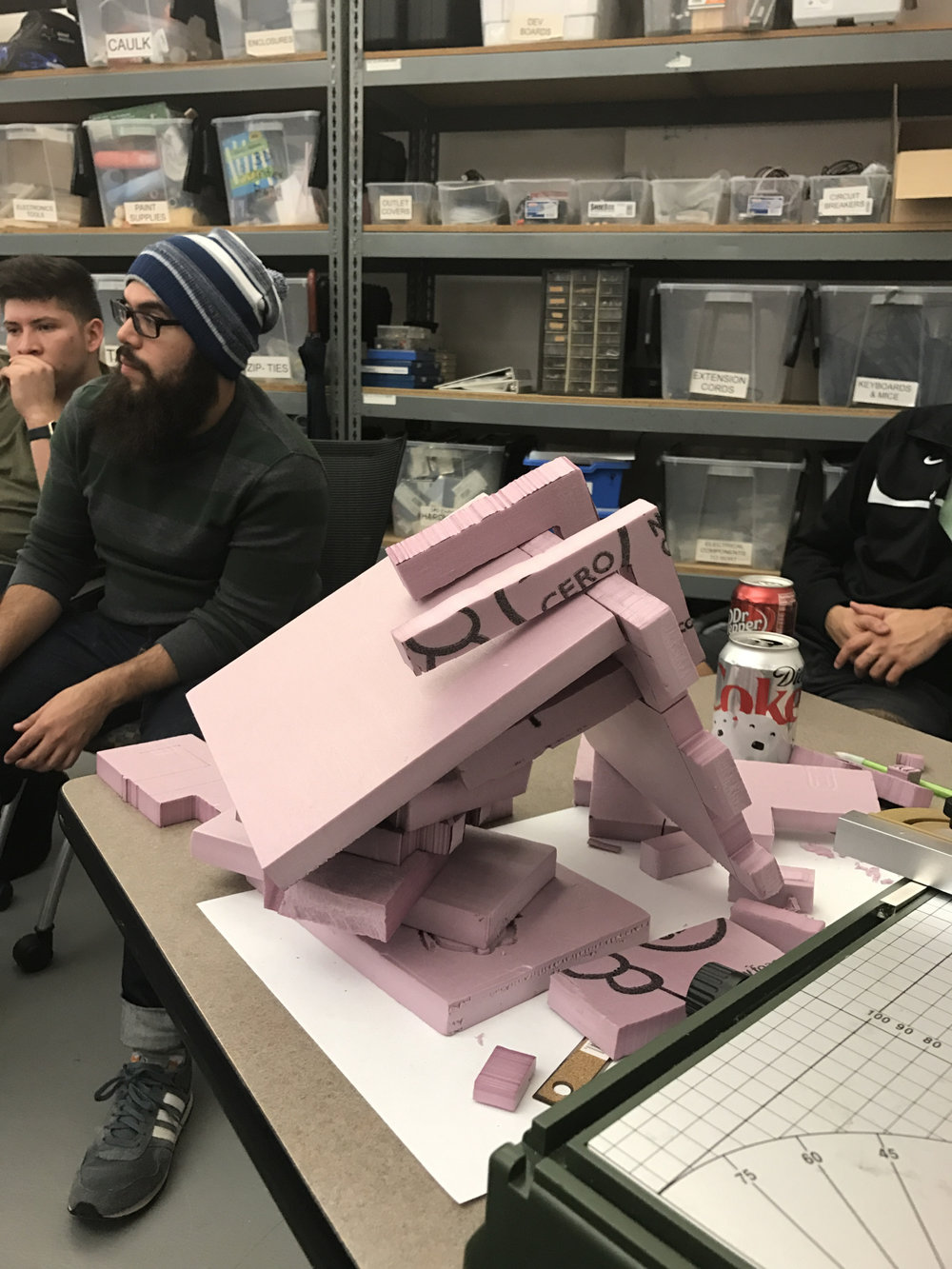 Building prototype connectors out of pink foam.