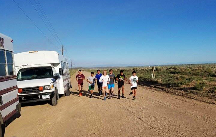 Alamosa High School men's team head out for a run out on the dirt mountain roads.  Photo credit to Larry Zaragoza.